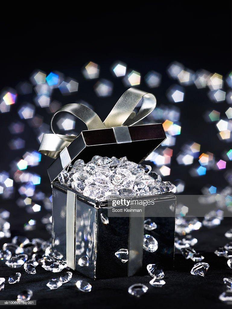 Gift box filled with diamonds, studio shot : Bildbanksbilder