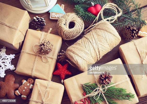 gift box on a wooden background - christmas gifts stock photos and pictures