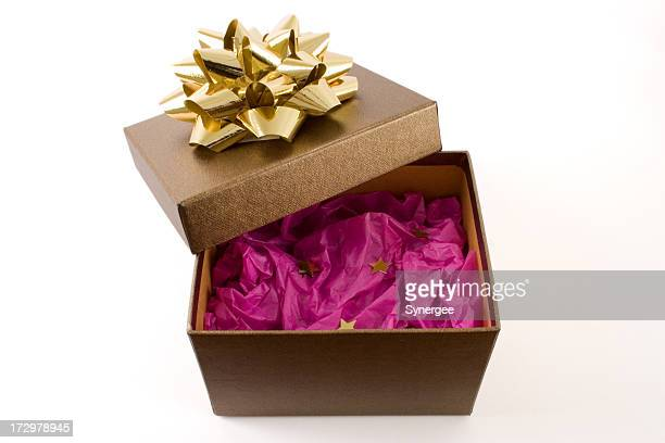 Gift box with golden bow with tissue paper