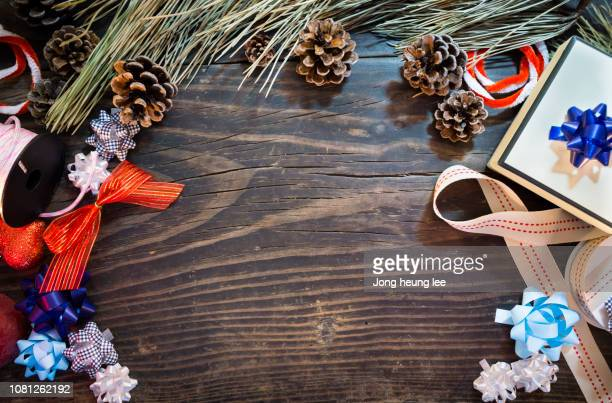 gift box with pine leaves and decorations on the table - jong heung lee stock pictures, royalty-free photos & images