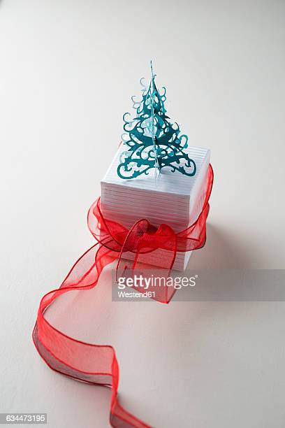 Gift box with red ribbon and Christmas tree