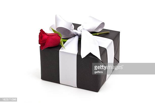 gift box with red rose - black rose stock photos and pictures