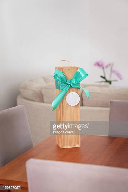 Gift box with ribbon on a table