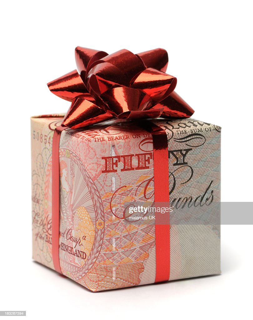 Gift box wrapped in an English pound with a red bow : Stock Photo