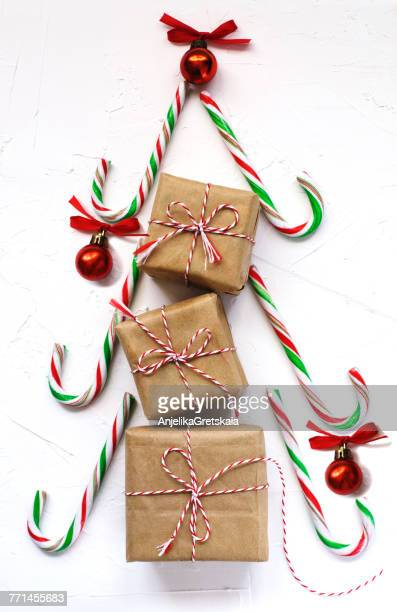 Gift boxes and candy canes in the shape of a Christmas tree