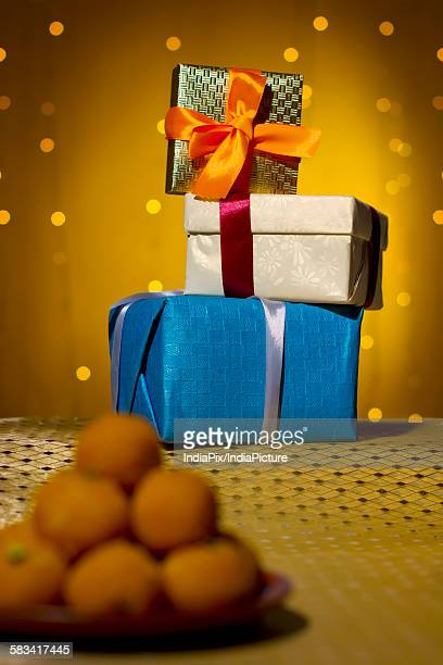 gift boxes stacked - mithai stock pictures, royalty-free photos & images