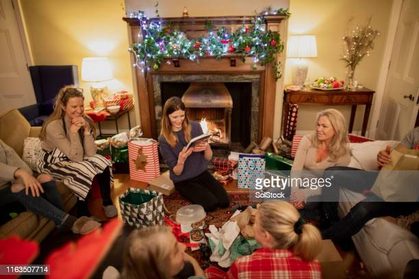 gift giving with friends - novelty item stock pictures, royalty-free photos & images