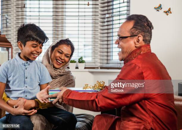 gift giving with his grandson - bangladesh mother stock pictures, royalty-free photos & images