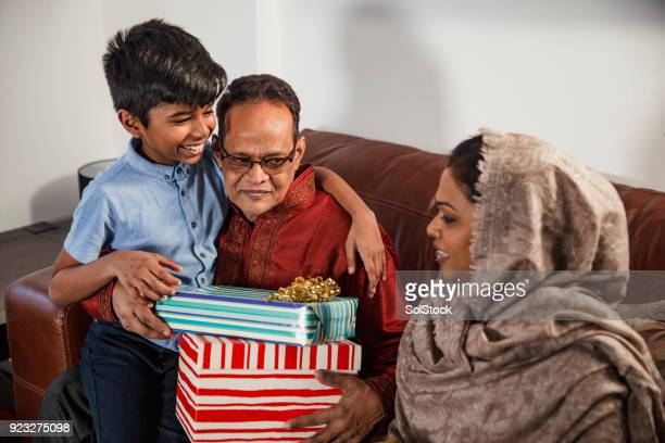gift giving with the family - eid ul fitr celebration in bangladesh stock pictures, royalty-free photos & images