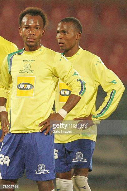 Gift leremi stock photos and pictures getty images gift leremi and shere lekgothoane look on during the confederation cup match between mamelodi sundowns and negle Image collections