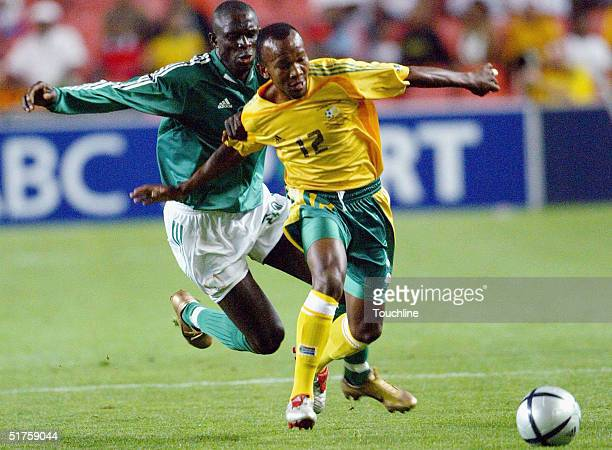 Gift leremi pictures and photos getty images gift leremi of south africa and paul obiefule of nigeria in action during the nelson mandela negle Images