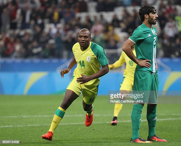 Gift motupa stock photos and pictures getty images gift motupa of south africa celebrates after scoring a goal during the mens first round group negle Images