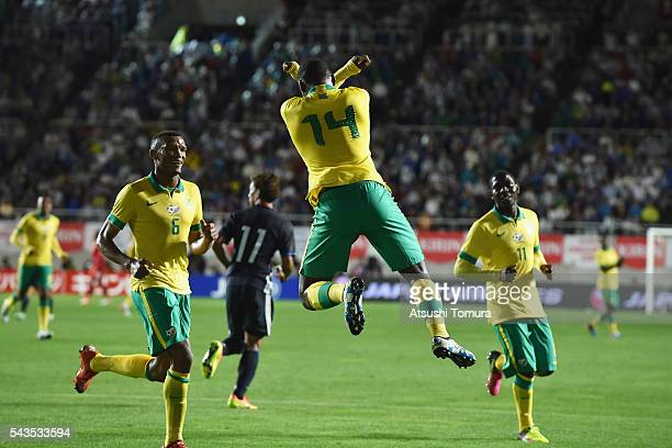 Gift motupa stock photos and pictures getty images gift motupa of south africa celebrates scoring the opening goal from the penalty spot during the negle Images