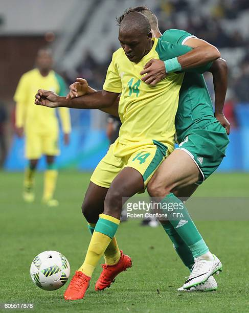 getty images gift motupa of south africa is challenged by suad natiq of iraq during the mens first negle Images
