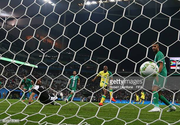 Gift Motupa of South Africa scores during the Men's First Round Group A match between South Africa and Iraq on Day 5 of the Rio 2016 Olympic Games at...