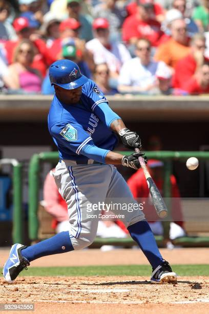 Gift Ngoepe of the Blue Jays puts the ball in play during the spring training game between the Toronto Blue Jays and the Philadelphia Phillies on...