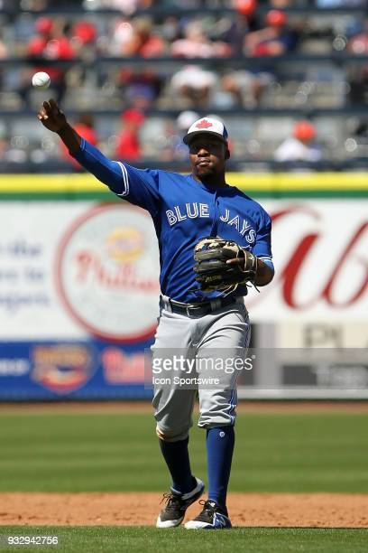 Gift Ngoepe of the Blue Jays throws the ball over to first base during the spring training game between the Toronto Blue Jays and the Philadelphia...