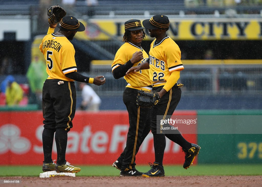 Gift Ngoepe #61 of the Pittsburgh Pirates celebrates with Andrew McCutchen #22 and Josh Harrison #5 after the final out in the Pittsburgh Pirates 1-0 win over the Philadelphia Phillies at PNC Park on May 21, 2017 in Pittsburgh, Pennsylvania.