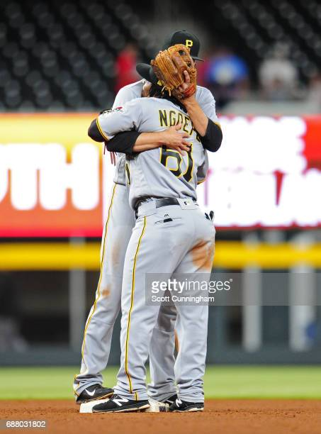 Gift Ngoepe of the Pittsburgh Pirates celebrates with Jordy Mercer after the game against the Atlanta Braves at SunTrust Park on May 24 2017 in...