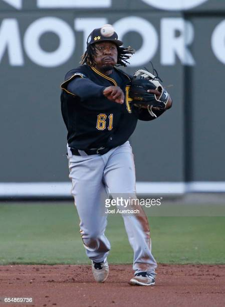 Gift Ngoepe of the Pittsburgh Pirates fields the ball hit by Hanley Ramirez of the Boston Red Sox in the second inning during a spring training game...