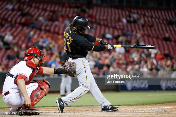 Gift Ngoepe of the Pittsburgh Pirates hits an infield single to drive in two runs against the Cincinnati Reds in the seventh inning of a game at...