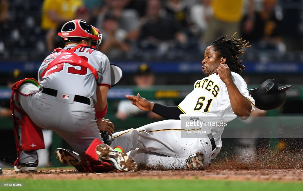 Gift Ngoepe #61 of the Pittsburgh Pirates is tagged out by Jose Lobaton #59 of the Washington Nationals during the eighth inning at PNC Park on May 17, 2017 in Pittsburgh, Pennsylvania.