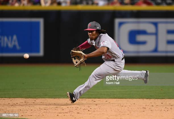 Gift Ngoepe of the Pittsburgh Pirates makes a play on a bouncing ball during the ninth inning against the Arizona Diamondbacks at Chase Field on May...