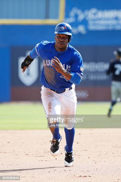 Gift Ngoepe of the Toronto Blue Jays advances to third base after a bad throw in the fifth inning of a Grapefruit League spring training game against...
