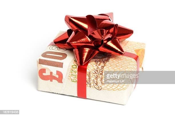 gift of money - ten pound note stock photos and pictures