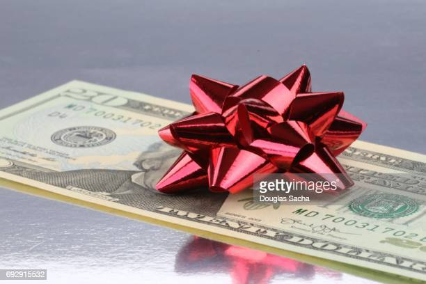 gift on money - hair bow stock pictures, royalty-free photos & images