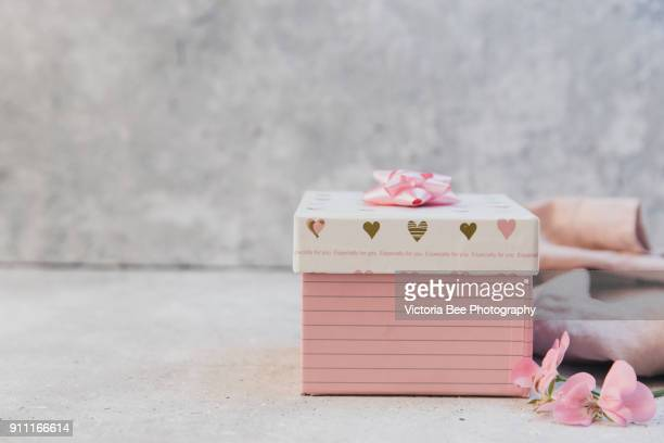 Gift or pink present on stone table
