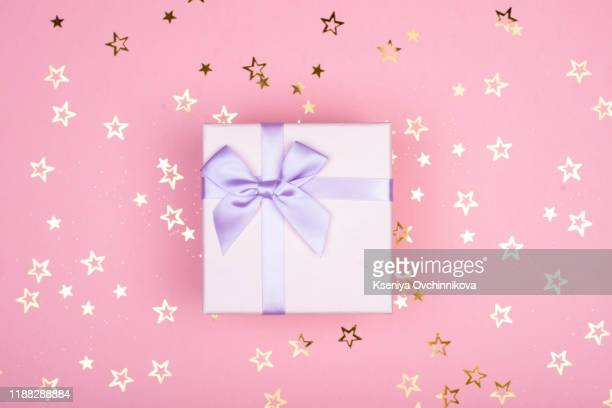 gift or present box and sequins on pink table top view. flat lay. birthday, wedding or christmas concept. - wedding background stock pictures, royalty-free photos & images
