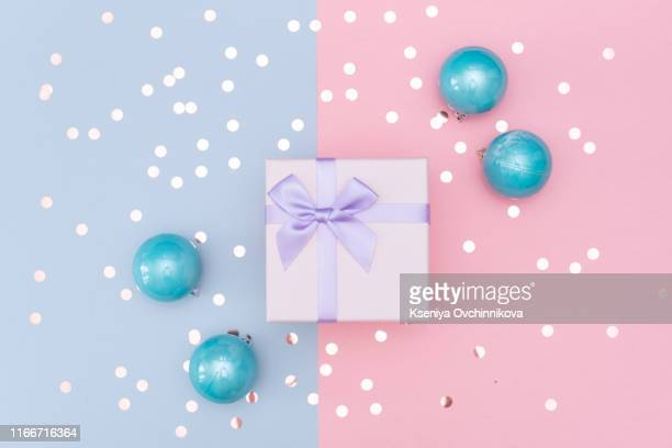gift or present box and stars confetti on pink table top view. flat lay composition for birthday, mother day or wedding. - wedding background stock pictures, royalty-free photos & images