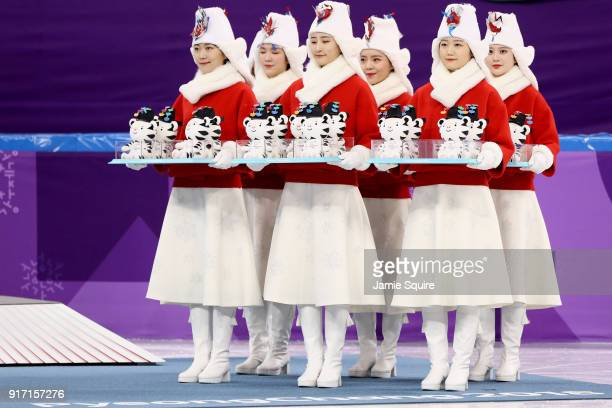 Gift presenters arrive for the victory ceremony for the Figure Skating Team Event on day three of the PyeongChang 2018 Winter Olympic Games at...