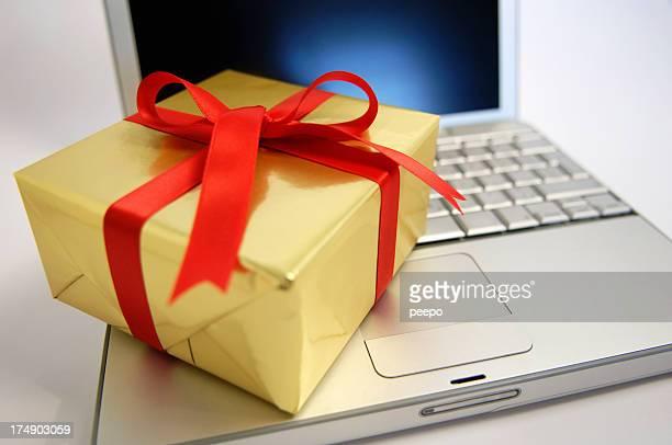 Gift Resting On Laptop