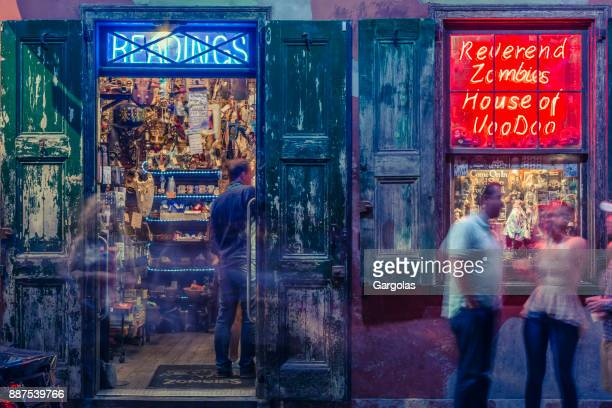 gift shop at night in the french quarter of new orleans, louisiana - mardi gras fun in new orleans stock photos and pictures