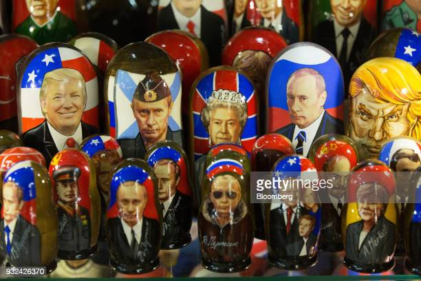 A gift shop displays souvenir matryoshka dolls decorated with the faces of Vladimir Putin Russia's president center left US President Donald Trump...