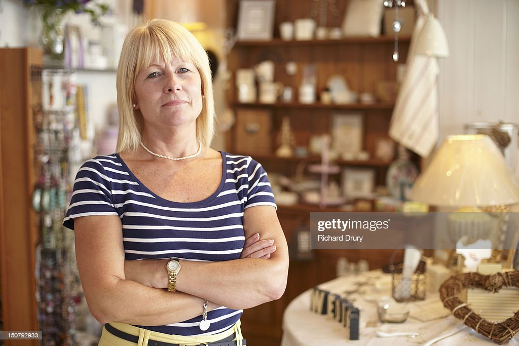 Gift shop owner in her shop : Stock Photo
