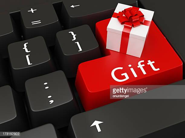 gift symbols on keyboard keys - gift icon stock photos and pictures