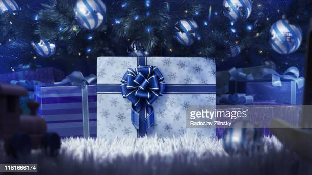 gift under the christmas tree - public celebratory event stock pictures, royalty-free photos & images