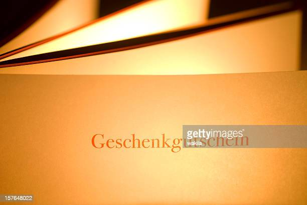geschenkgutschein - german gift coupon - coupon stock photos and pictures
