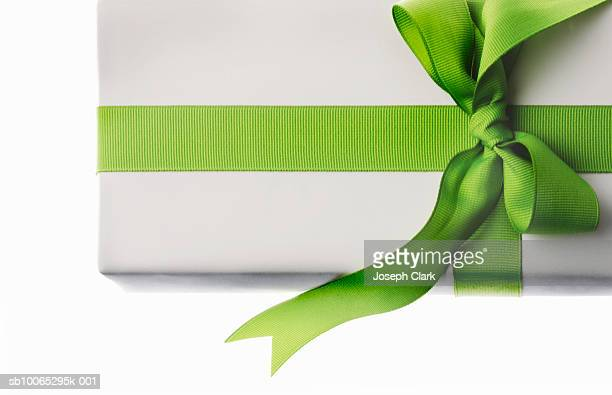 Gift with green ribbon, overhead view