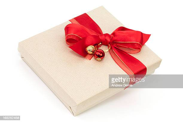 gift with red bow - andrew dernie stock pictures, royalty-free photos & images