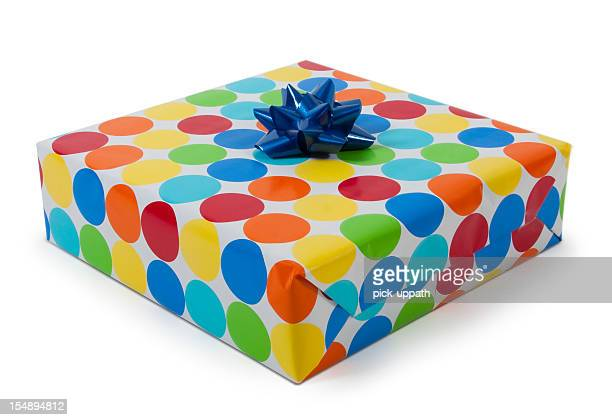 Gift wrapped in spotty paper with blue bow