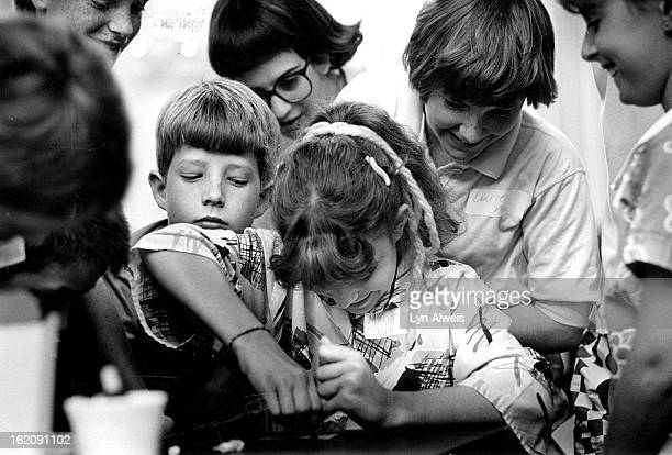 7161987 Gifted students visit a blood bank Melisa Van Allen attempts tp squeeze a drop of blood from her finger so that she can type it Other...