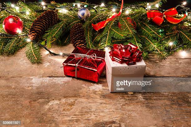 Gifts and christmas decoration on table