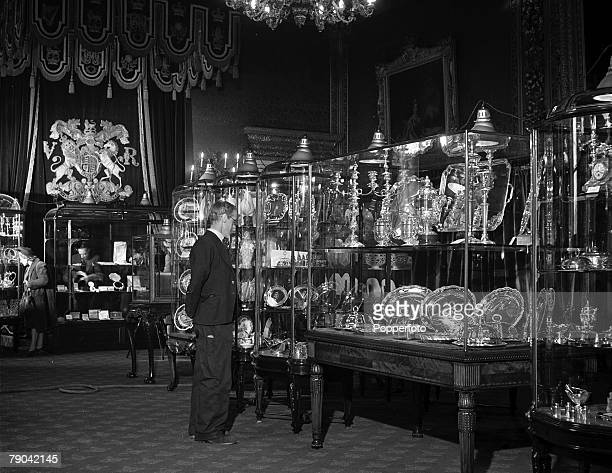 Gifts presented to Princess Elizabeth and the Duke of Edinburgh for the occasion of their wedding are displayed in glass cabinets at St James Palace...