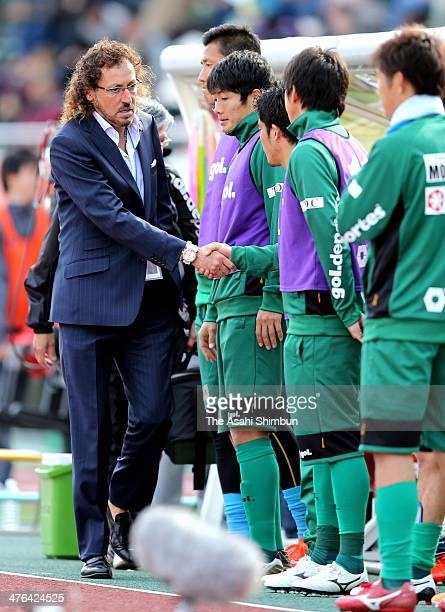 Gifu head coach Ramos Ruuy shakes hands with his players after the win over Kamatamare Sanuki during the J League second division match between FC...