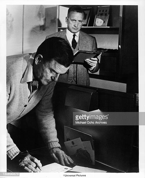Gig Young sends a wire while George Scott scrutinizes his actions in a scene from the film 'The Hindenberg' 1975