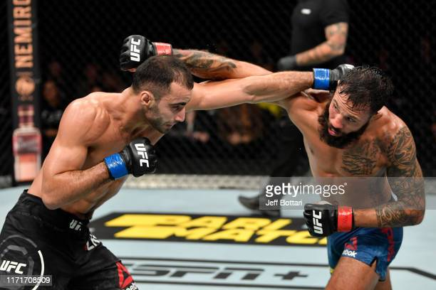 Giga Chikadze of Georgia and Brandon Davis exchange punches in their featherweight bout during the UFC Fight Night event at Royal Arena on September...